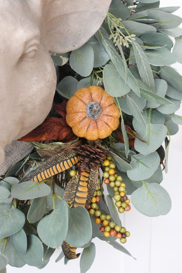 adding-floral-picks-to-a-plain-wreath | the everyday home | www.everydayhomeblog.com