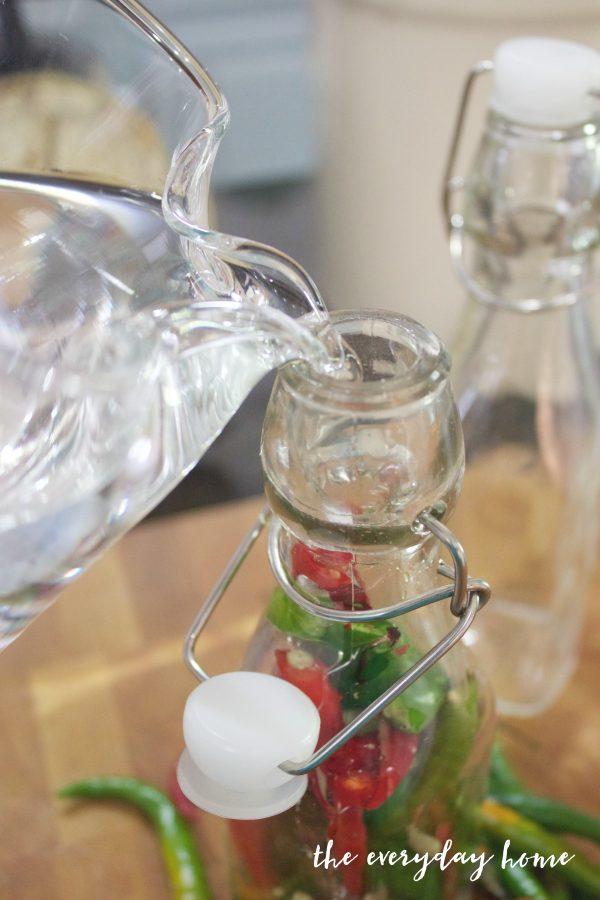 adding-vinegar-to-pepper-vinegar-jars | The Everyday Home | www.everydayhomeblog.com
