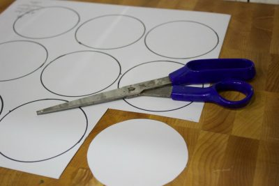 cutting-scrapbppk-paper-for-christmas-ornaments | The Everyday Home | www.everydayhomeblog.com