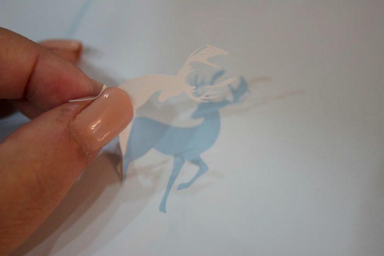 peeling-off-deer-sticker-for-christmas-ornament | The Everyday Home | www.everydayhomeblog.com