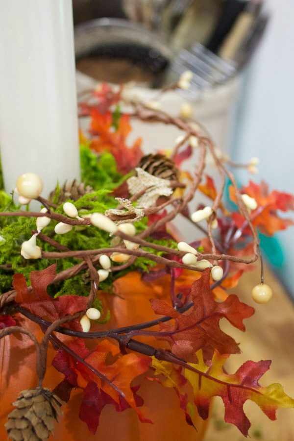 adding-berries-to-a-pumpkin-candleholder-planter | The Everyday Home | www.everydayhomeblog.com