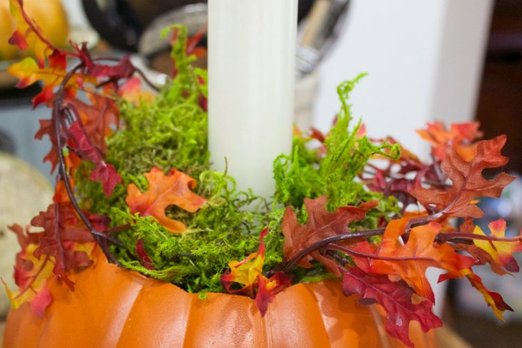 adding-fall-leaves-to-pumpkin-candleholder-planter | The Everyday Home | www.everydayhomeblog.com
