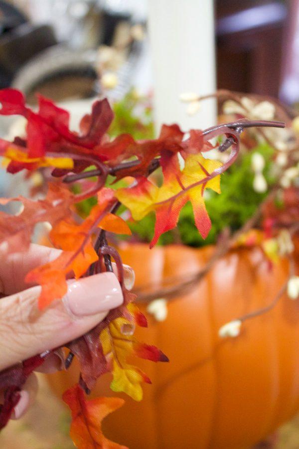 adding-sprigs-of-leaves-to-a-pmpkin-candleholder-planter | The Everyday Home | www.everydayhomeblog.com