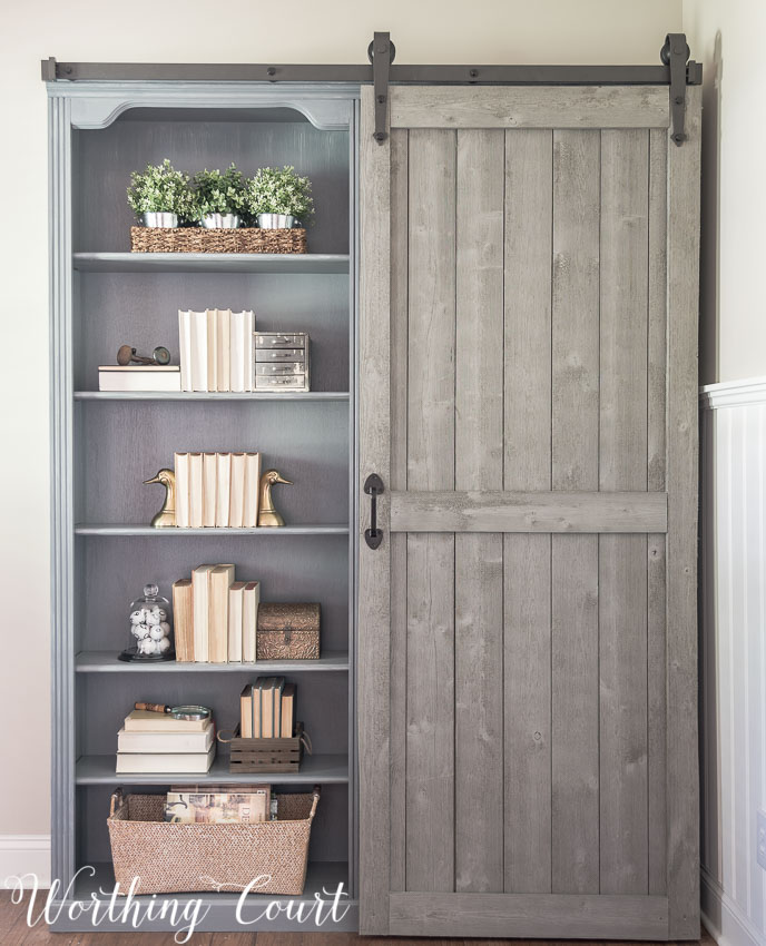 farmhouse-style-bookcase-makeover-with-hidden-storage-behind-sliding-door